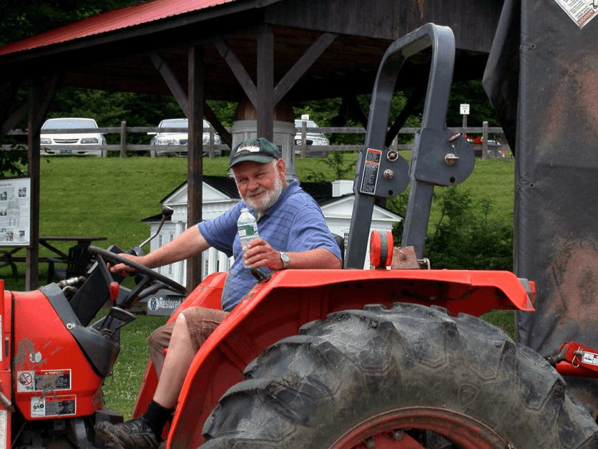 Image of Burr Morse on tractor at Morse Farm Sugarworks