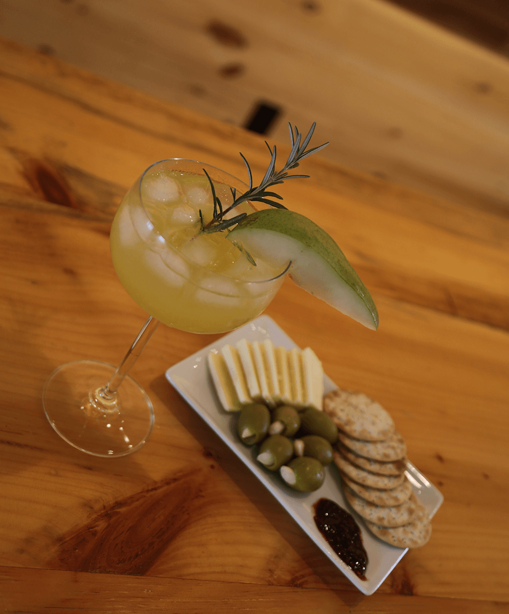 Image of cheese plate and mixed drink at Wild Hart Distillery