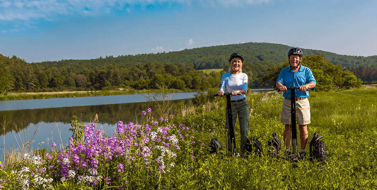 Image of people on Segways in a field at Quechee Gorge Village