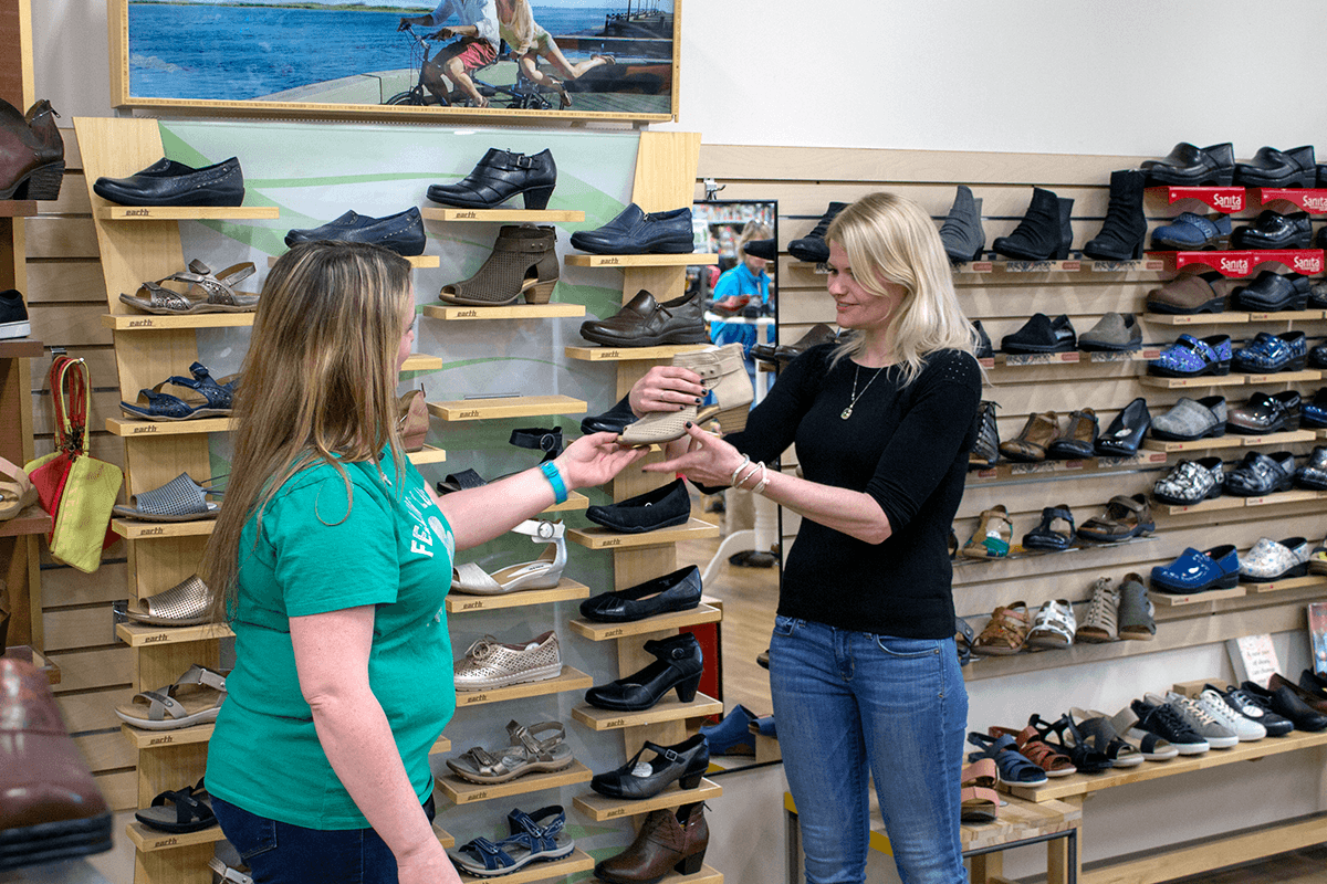 Image of woman shopping shoes at Farm-Way