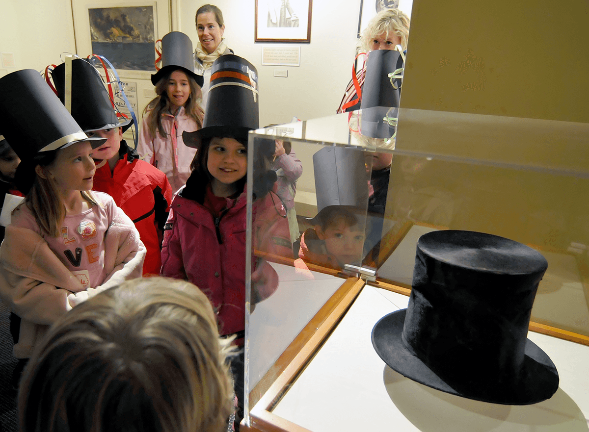 Image of kids with top hats at Hildene, The Lincoln Family Home
