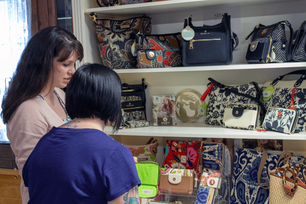 Image of women at handbags at Farm-Way