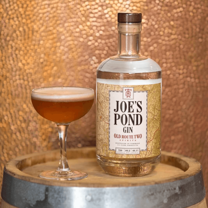 Image of a gin cocktail on a barrel top at Old Route Two Spirits