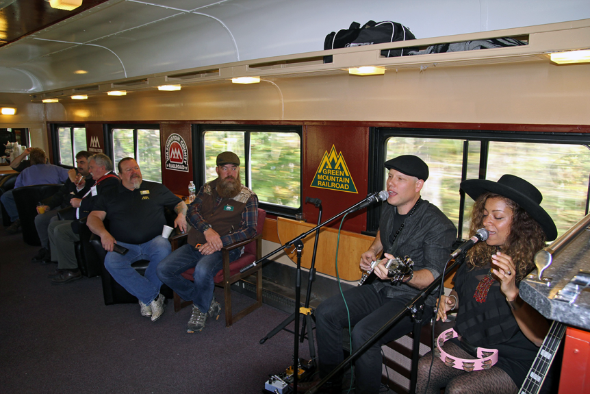 Image of musicians singing aboard the Green Mountain Railroad