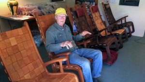 Image of man sitting in a rocking chair from Vermont Folk Rocker