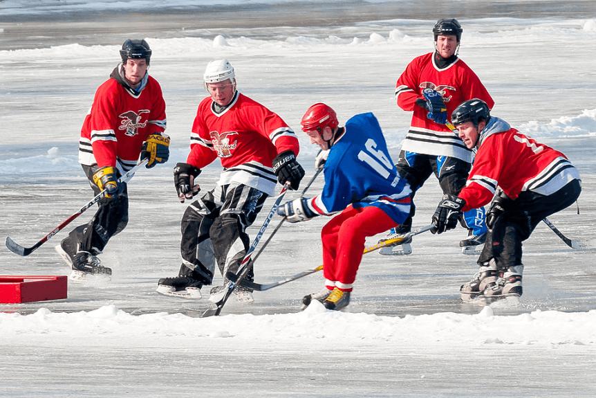 Image of men playing hockey at Lake Morey Resort