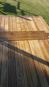 A wooden deck that was professionally power washed by Vermont Home Wash in Williston, VT