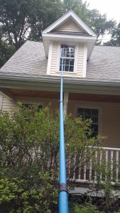 Our streak-free window cleaning service in Burlington, VT is done with long water-fed poles such as this 45-foot carbon pole.