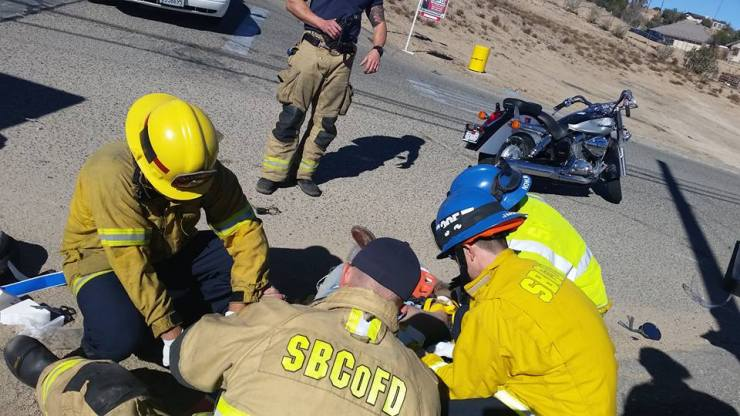 Firefighters treating a motorcyclist after a crash. (Photo courtesy of SBC Fire)
