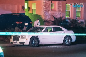 A white Chrysler 300 was riddled with bullets, leaving a passenger dead. (Gabriel D. Espinoza, Victor Valley News)