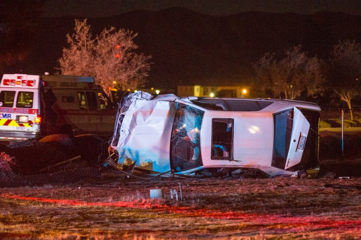 The white sedan rolled an unknown amount of times before resting in the yard of house. (Gabriel D. Espinoza, Victor Valley News)