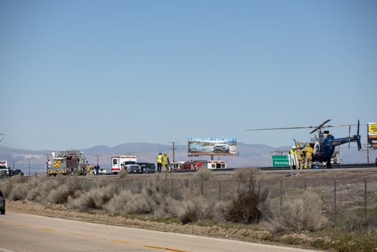 Three air ambulances landed on the southbound side of the 15 freeway near Oak Hill Road. (Hugo C. Valdez, Victor Valley News)