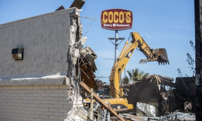 An excavator preparing to lift debris at the former Coco's on Palmdale Road. (Hugo C. Valdez, Victor Valley News)