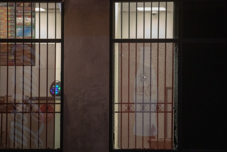 A bullet hole shattered the window of a business in the shopping center. (Gabriel D. Espinoza, Victor Valley News)