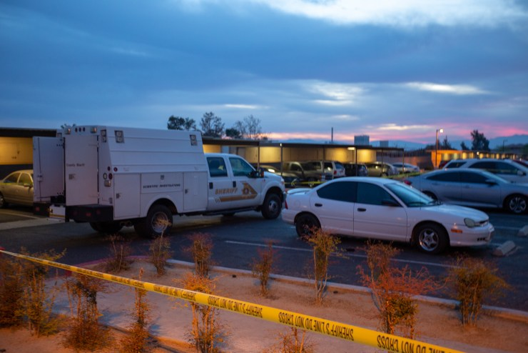 A large area of the parking lot was taped off with crime scene tape (Hugo C. Valdez, Victor Valley News)