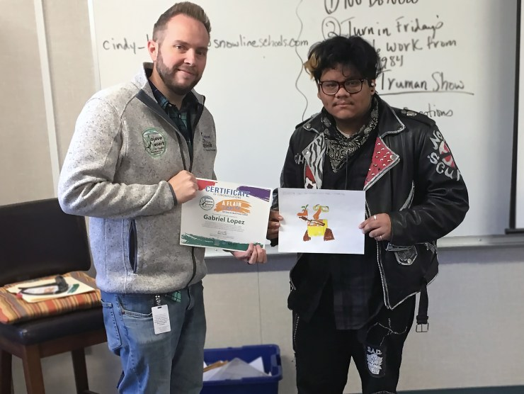 Gabriel Lopez, a junior at Chaparral High School in Phelan, recently won a new bicycle after being randomly selected among hundreds of submissions in the 2019 Clean Air Month Poster Contest, hosted by the Mojave Desert Air Quality Management District. Gabriel is shown, right, with MDAQMD Community Relations and Education Specialist Martial Haprov. Photo courtesy of Jorge Camacho, MDAQMD