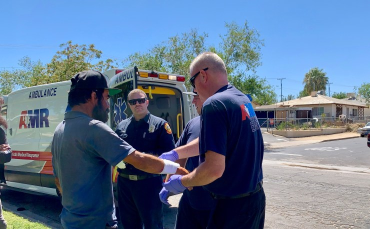 AMR paramedics and Victorville City Fire treated the male before transporting him to a local hospital. (Hugo C. Valdez, Victor Valley News)