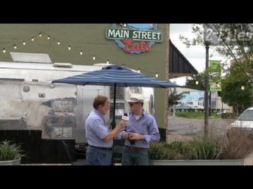 Z FILES Cal Zethmayr with Nathan Boyles about Sign Permit on wall for Crestview Eats
