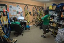 Thinking through the shift to report on what we did - exactly how many people did we talk to? On the wall: our six bike fleet is a tight fit but we have bikes in all sizes to fit a varied team