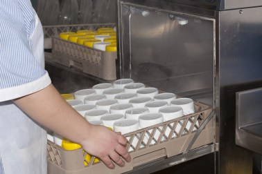 Dishware is sanitized in a dishwasher for diner safety