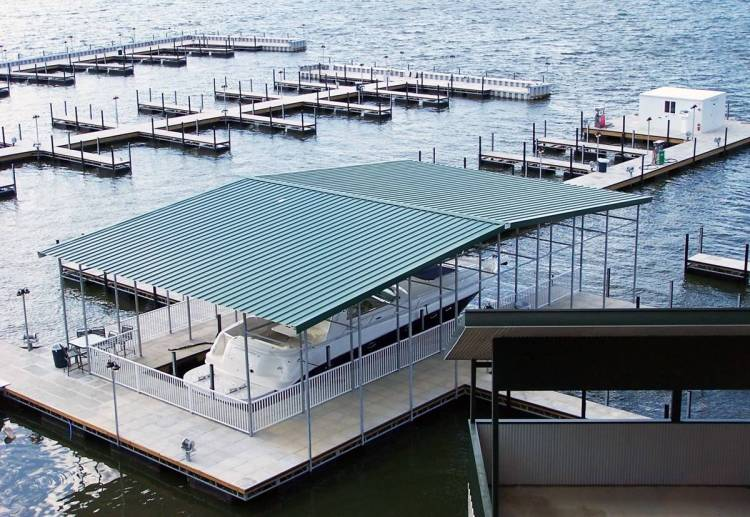 wahoo aluminum docks commercial dock - commercial marine construction - green gable roof with concrete pavers decking