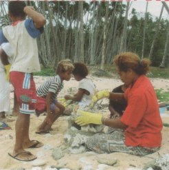 Children and ladies of Waitabu village building the fish houses