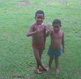 Cuclone - kids playing in rain