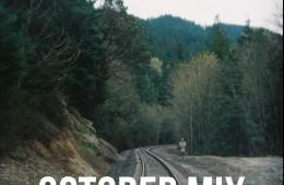 october cover art photograph tress train tracks
