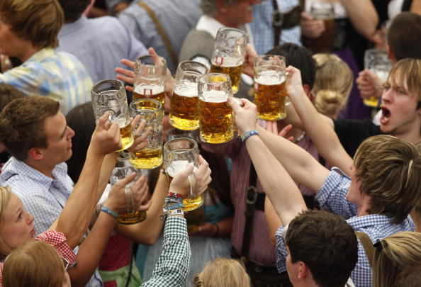 Visitors cheer with beer mugs beer in a tent on the opening day of the 177th edition of the Oktoberfest beer festival at the Theresienwiese in Munich, southern Germany, on September 18, 2010. The world's biggest beer festival Oktoberfest, celebrating the 200th birthday since its creation, runs until October 4, 2010. AFP PHOTO / SEBASTIAN WIDMANN (Photo credit should read SEBASTIAN WIDMANN/AFP/Getty Images)