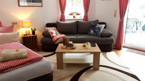 Wohnzimmer Sofa Ferienwohnung Wald Kobel