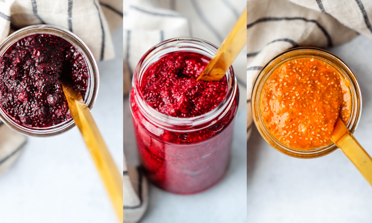 blueberry, raspberry, and apricot chia jams in glass jars with gold knives