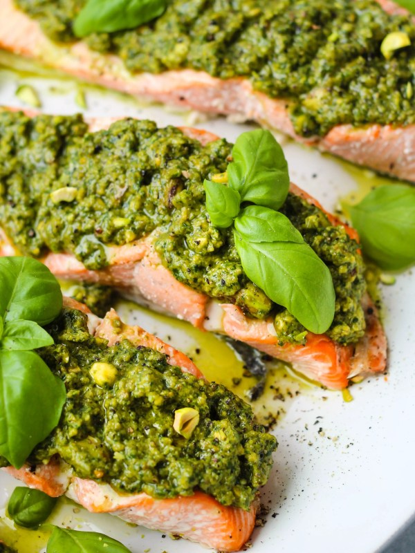 easy baked salmon topped with pistachio pesto