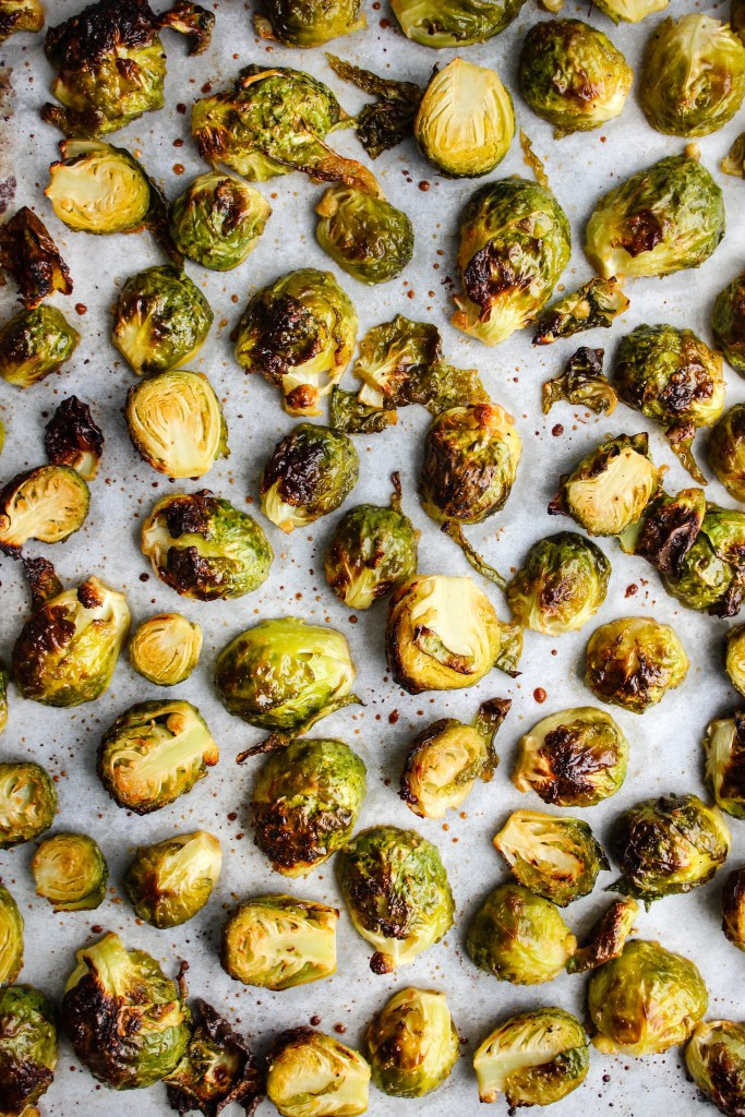 honey and garlic roasted brussels sprouts on baking sheet