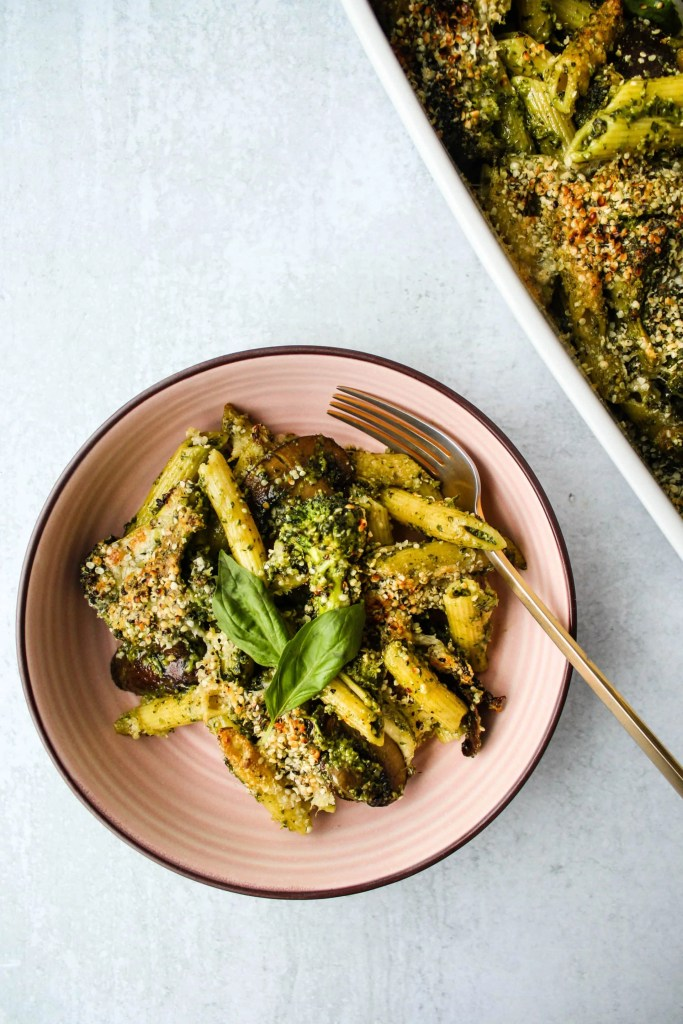 baked pesto pasta in a pink bowl