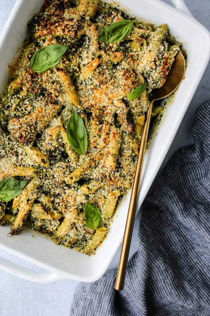 pesto pasta bake in white casserole dish