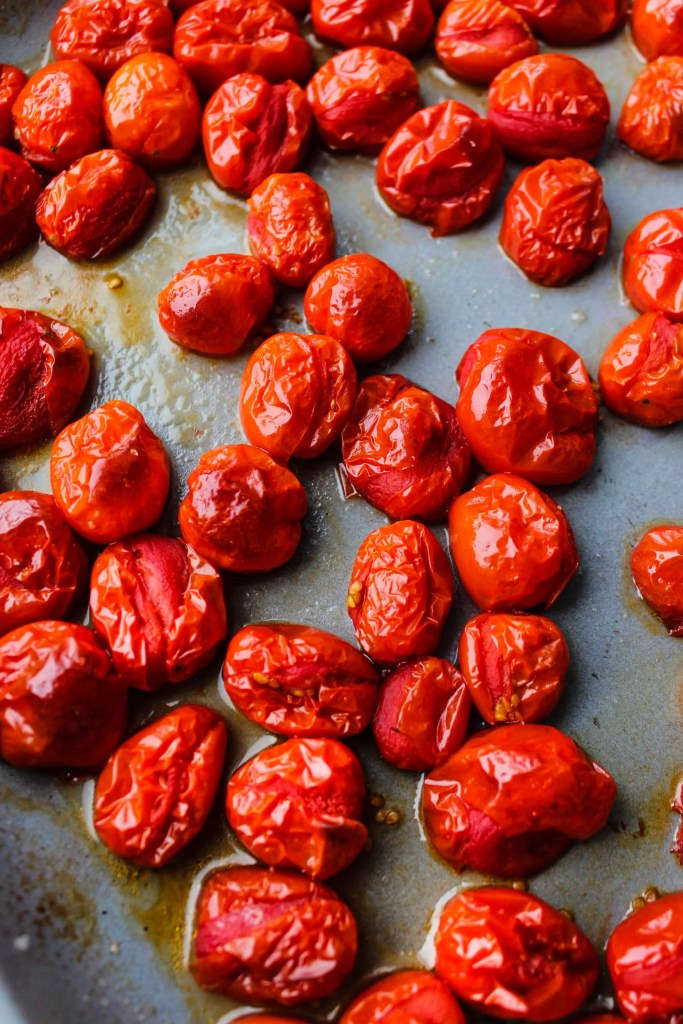 roasted cherry tomatoes on a baking sheet