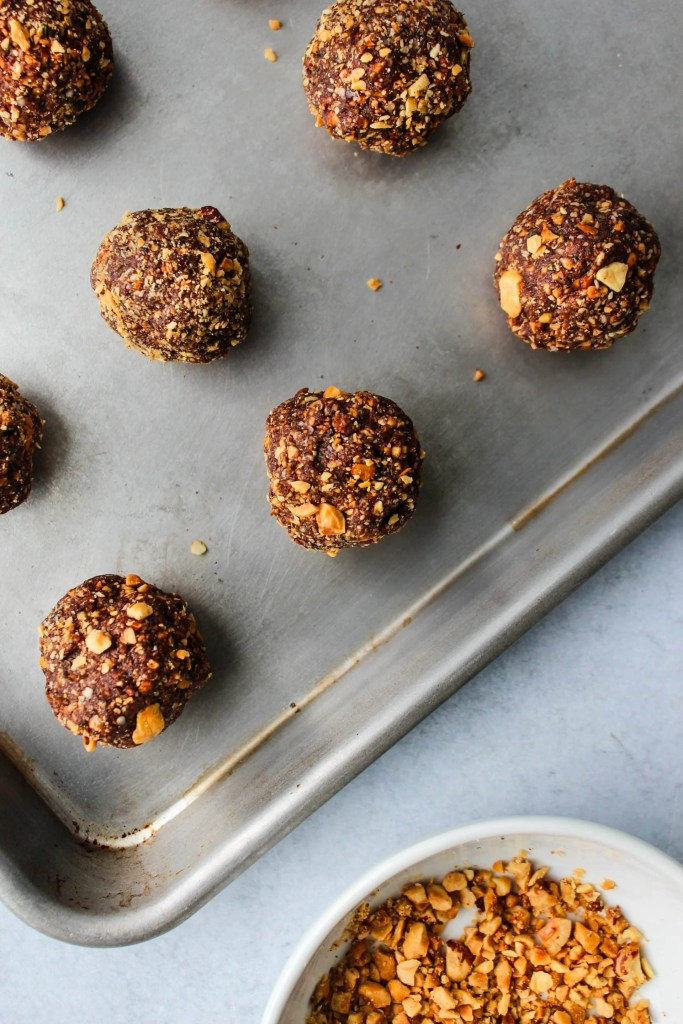 chocolate hazelnut bliss balls on baking sheet