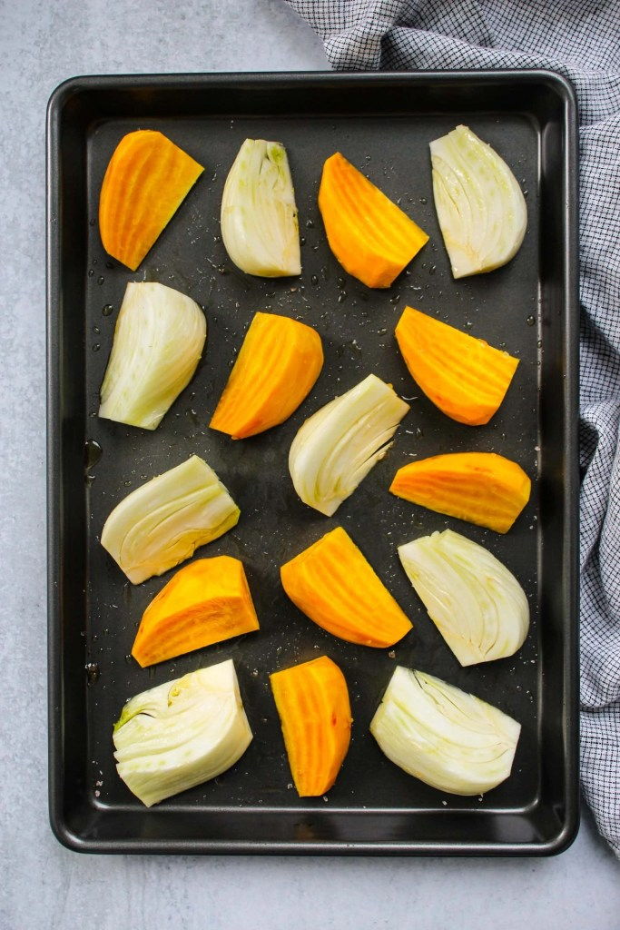 baking sheet with chopped beets and fennel chunks