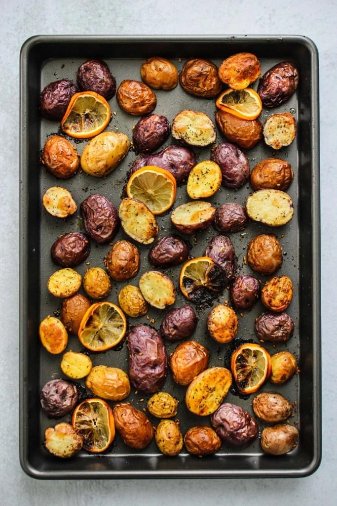 baking dish with roasted mini potatoes and lemon