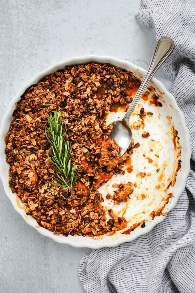 rosemary apricot crisp in white baking dish and blue dish towel