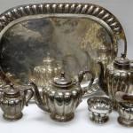 Oval tray, teapot, hot-water jug, sugar basin, lidded sucrier, cream-jug.