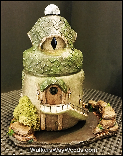 Rear of Dragon's Eye Den on stone base