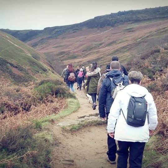 Hikers head up the valley