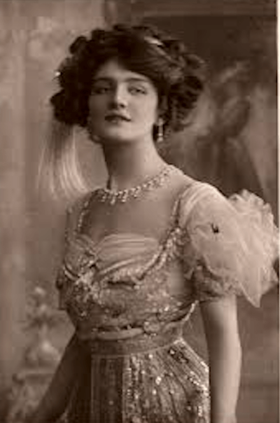 Black-and-white photo of an Edwardian-era woman in formal dress.