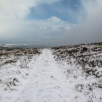 Snow covered footpath on Burley Moor