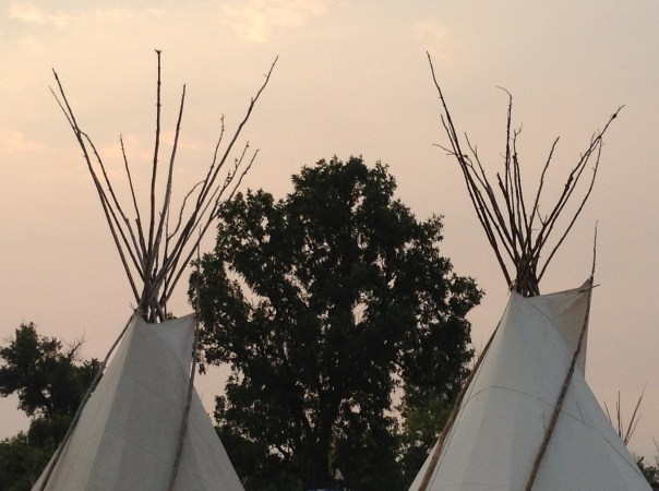 Two teepees at the Crow Fair and Powwow, Crow Agency, Montana. Copyright 2013, Kim Cotton.