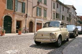 Little Vintage Fiat Car On The Street Of Verona