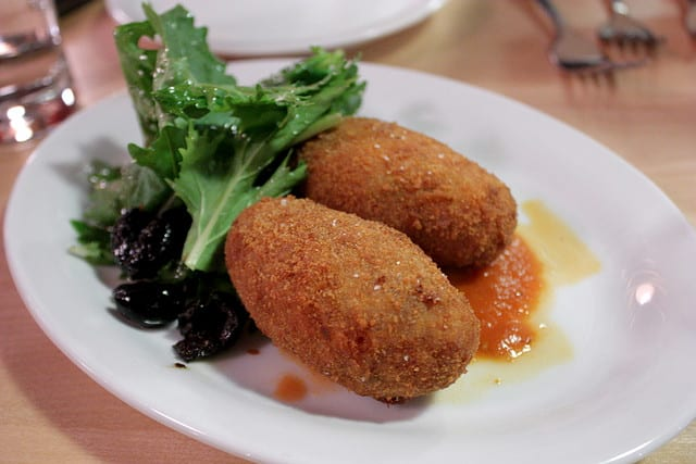 These succelent supplí contain a gooey center of molten mozzarella. Find out Rome's other favorite jewish foods and why they should be on every list of what to eat in Rome!