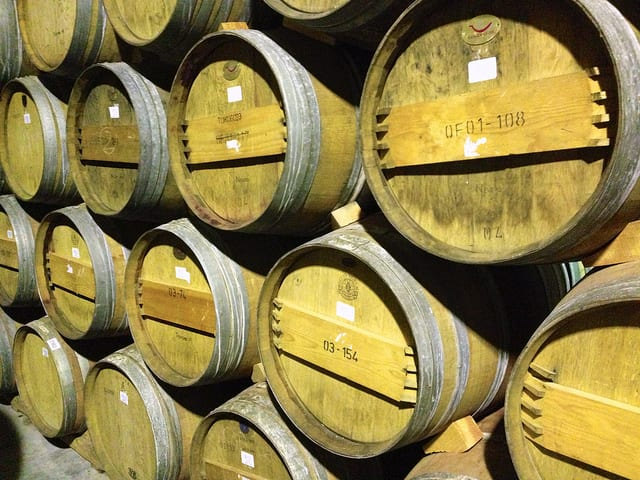 Many of the best Italian wines are aged in white oak barrels like these | photo by Jon Connell via Flickr https://www.flickr.com/photos/ciamabue/9536003395/in/photolist-fwEvzD-Ah6mTz-ANXLsy-aN43Wk-8XHtHL-qwfDN2-q1fVFT-fjopij-jWdbRH-bQ6esp-bvyKQ5-afKW6M-cw1A43-apT1ER-aDdxRj-aDdyaL-9B5271-9oTCM9-aDbmYZ-9KjSiD-9KnGc7-cU5XxN-9KnG1m-aDf8S9-iAPqNu-gnr2d9-AxZsp6-fFiErQ-hVteBd-67afaP-hen7V9-67fjnS-7QpqY4-7Qpr36-dAp97v-aDmo2C-aDmog3-aDfebQ-aDbnbn-aDf8FS-aDhgQH-67ftZL-9KoFA1-rdq2hA-dU9K6S-djn4yv-dAp9UP-afuNeq-4wBSgJ-rHPs2m