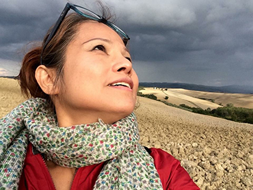 Woman in front of landscape in Tuscany during Walk the Arts art retreat in Italy for all levels